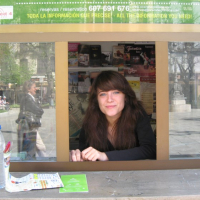young woman at information booth