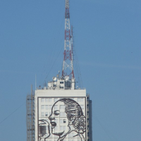 Buenos Aires radio tower with mural of female announcer