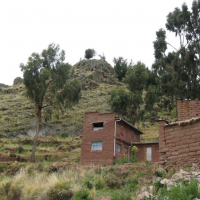 hillside with brick building